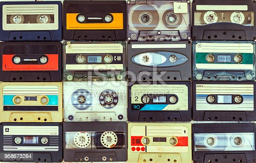 collection of various vintage audio cassettes. retro styled background