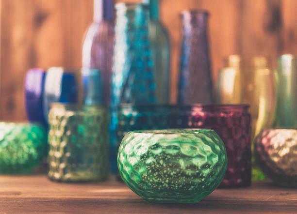 collection of vibrant colored glass bottles, jars and bowls - vase glas stock-fotos und bilder