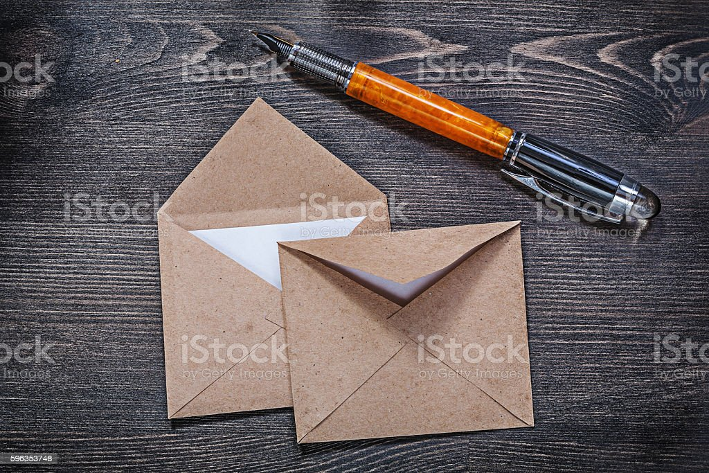 Collection of vintage post envelopes fountain pen on wooden boar royalty-free stock photo