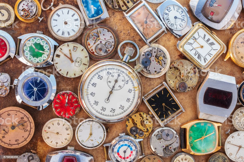 Collection of vintage rusty watches and parts stock photo