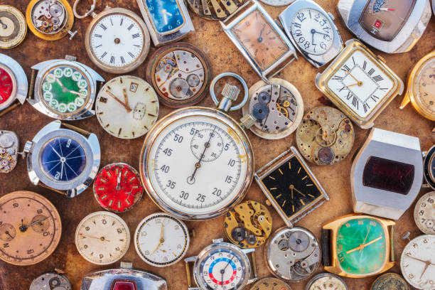 collection of vintage rusty watches and parts - watch timepiece stock photos and pictures