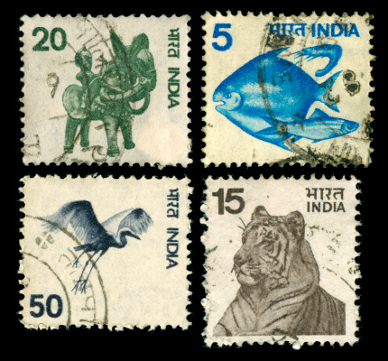 Set of old stamps from India with nature motif, scanned on black background. In aRGB colorspace for optimal printing.