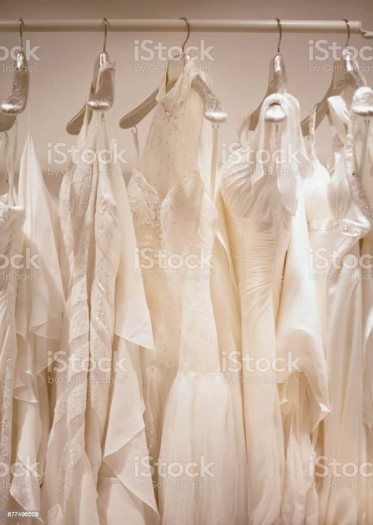 Collection of wedding dresses in a shop stock photo