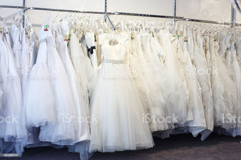 Collection of wedding dresses in the shop - Royalty-free Beautiful People Stock Photo