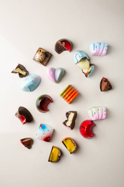 Collection of whole and crashed chocolate candies top view stock photo