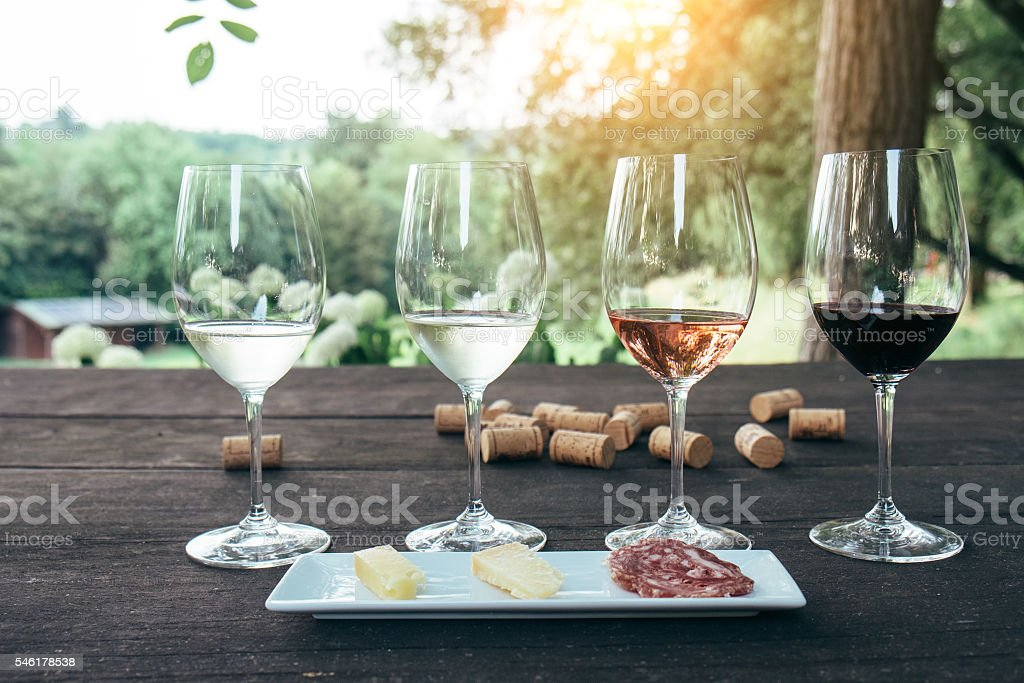 Collection of wine glasses on wooden table stock photo