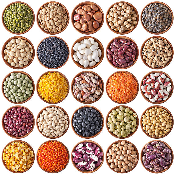 collection of wooden bowls with legumes - bean stock photos and pictures