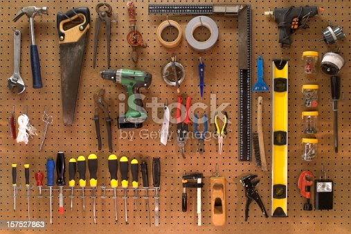 Wall with a collection of working tools for home improvement and do it yourself. Neatly organized on the wall you find among others; screwdrivers,hammer,saw,level, cutters,drill and tape.