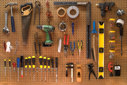 Collection of work tools on a wall board