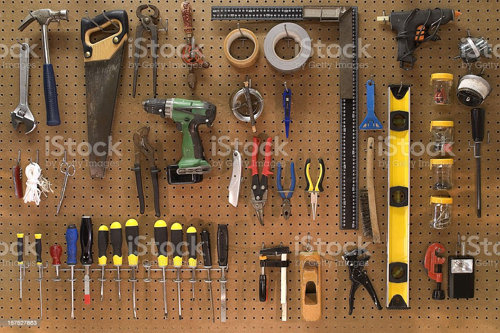 Collection of work tools on a wall board stock photo