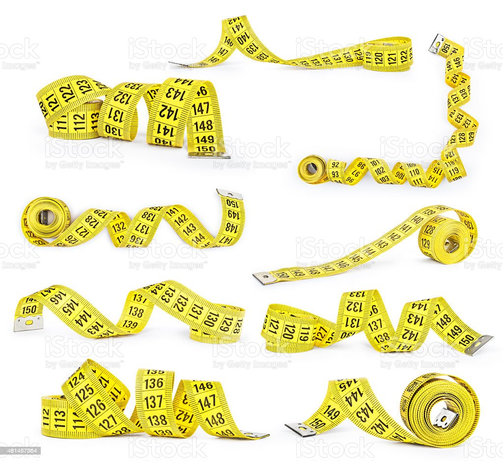 collection of yellow measuring tape on an isolated white background stock photo