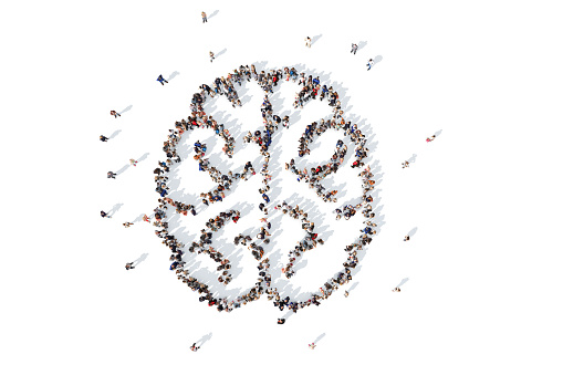 Large collection of people grouped together to form a brain icon