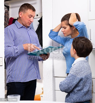 Collector is trying to get the arrears from woman with teen boy at home door