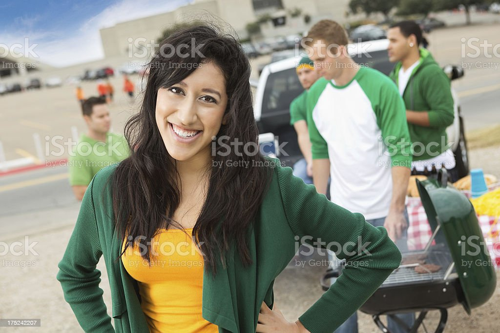 College age girl tailgating with friends at football stadium royalty-free stock photo