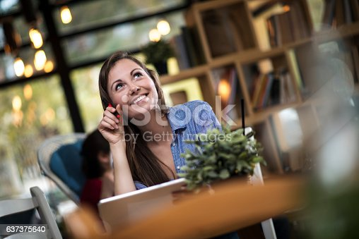 694187664 istock photo College age girl writing in journal at coffee shop 637375640
