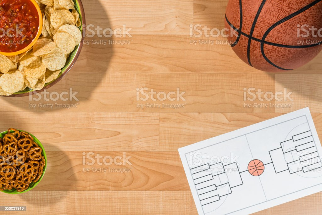 College basketball tournament party with empty 16 team bracket stock photo