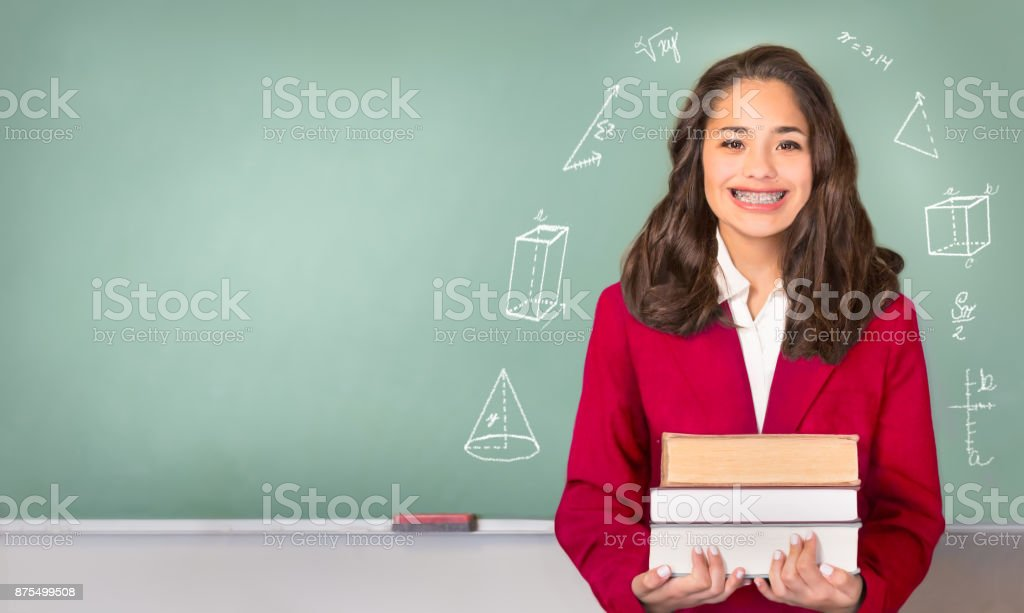 College Bound. Pretty ethnic or Hispanic teen in Front of Chalkb stock photo