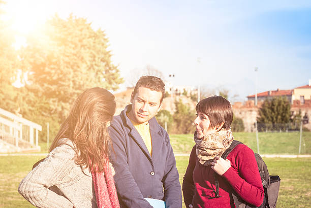 College campus student outdoors talking stock photo