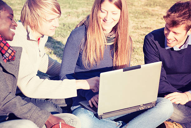 college campus student studing outdoors with laptop - 18 23 months stock photos and pictures