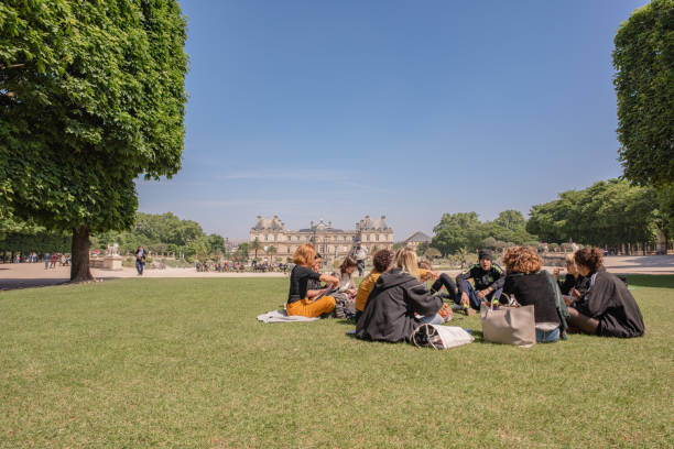 College class meeting for lunch in the Luxembourg Gardens in Paris stock photo