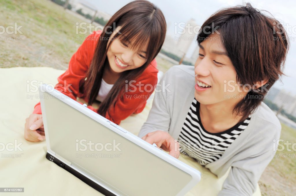 College couple into the laptop royalty-free stock photo