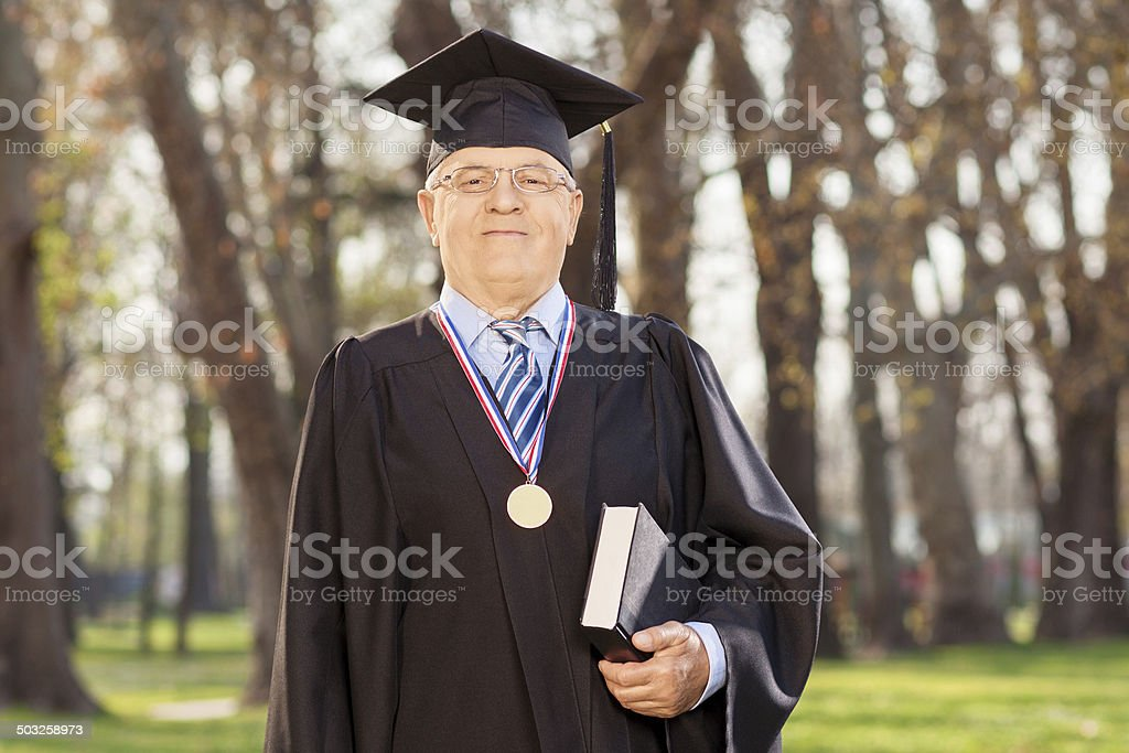 College dean posing with a book stock photo