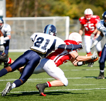 College Football Catch And Tackle Stock Photo - Download Image Now