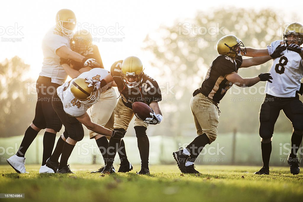 College Football - Catch and Tackle. stock photo