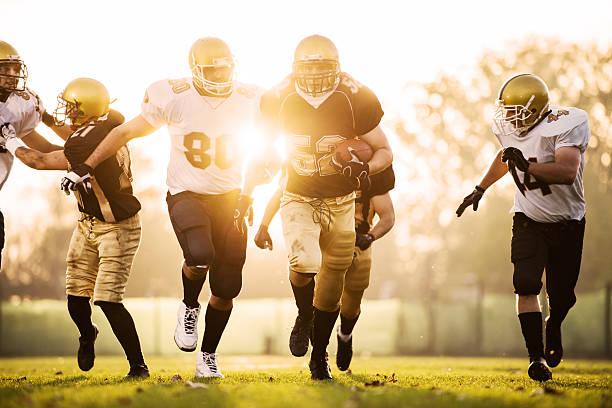 College Football-Sie und in Angriff genommen werden. – Foto