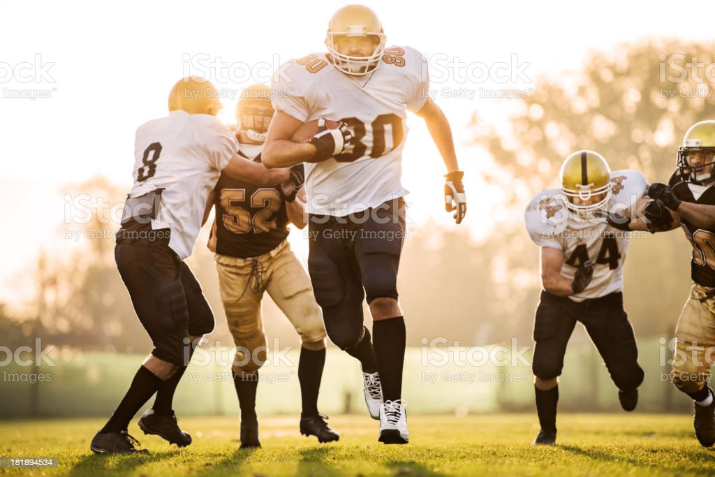 College Football - Catch and Tackle. royalty-free stock photo