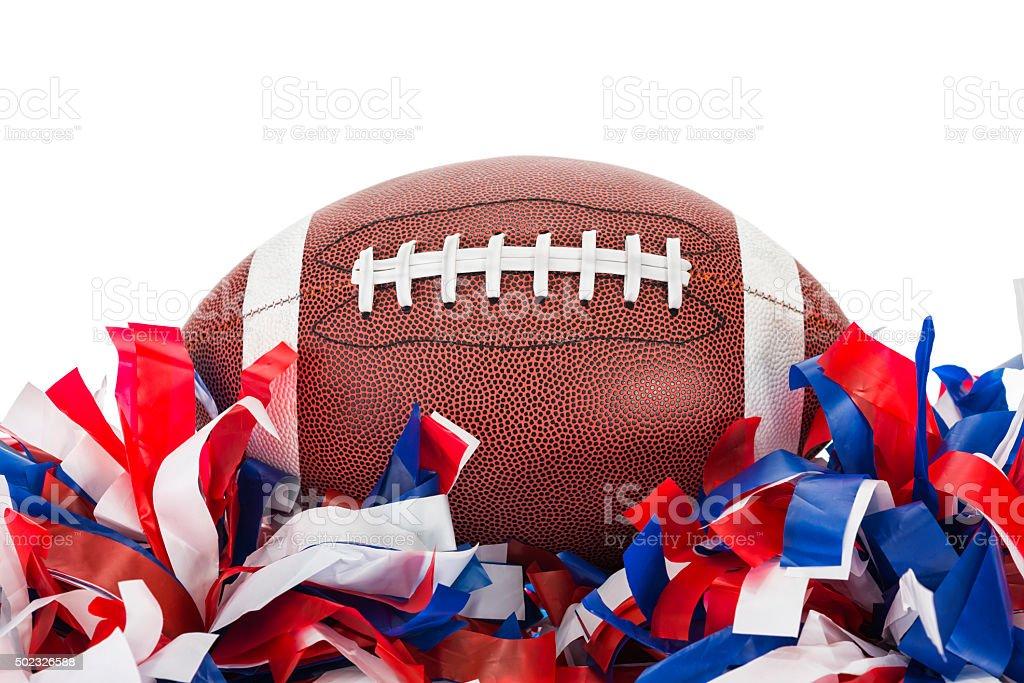 College football sitting atop pom poms, white background stock photo
