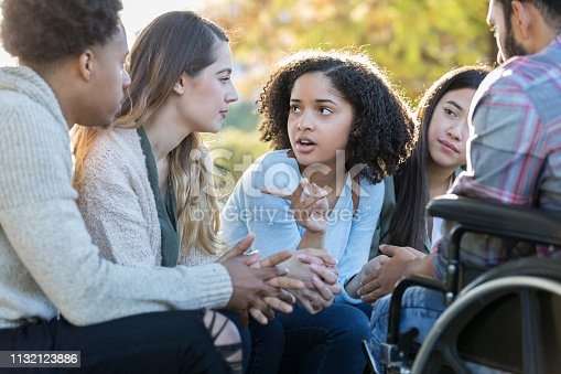 istock College friends have serious conversation 1132123886