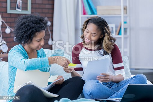 istock College friends study together in dorm room 668442780