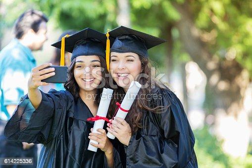 istock College friends take selfie after graduation 614225336