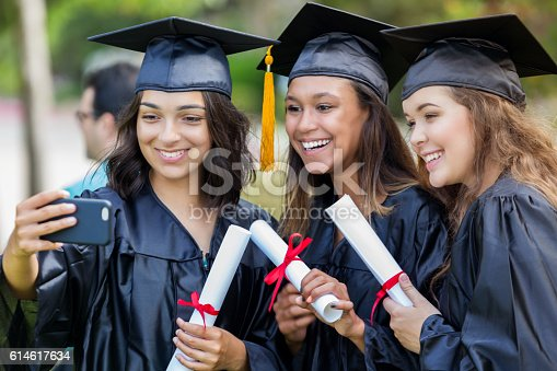 istock College friends take selfie after graduation 614617634
