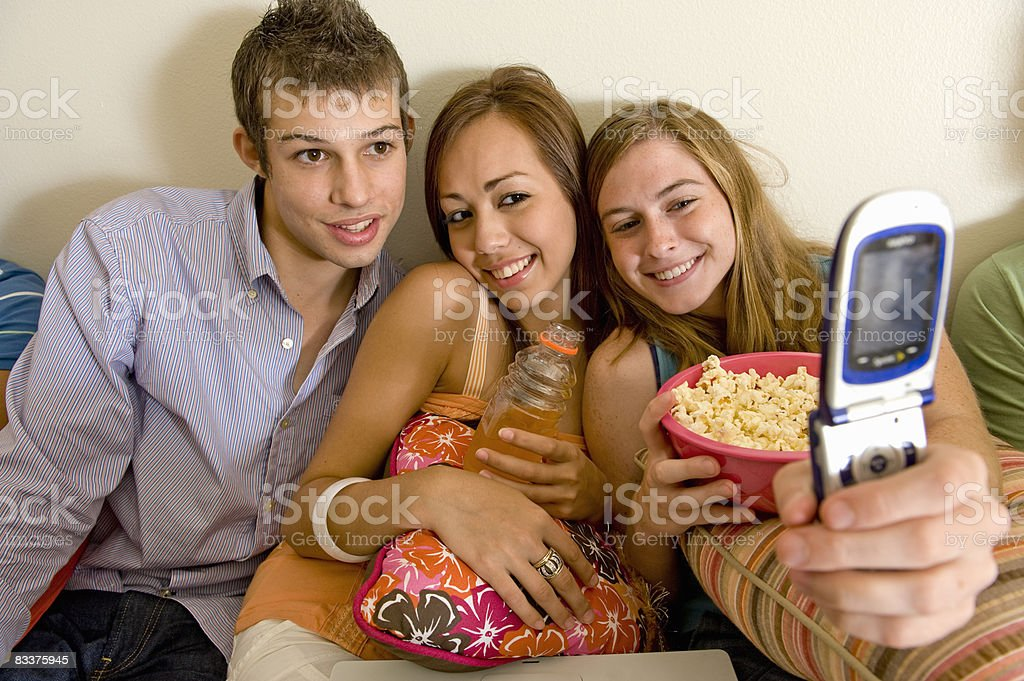 College friends  taking photo on phone foto stock royalty-free