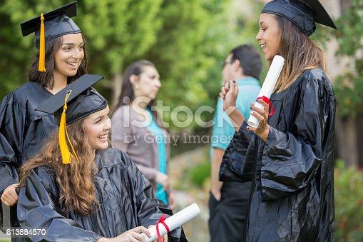 istock College friends talk after graduation 613884570