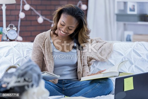 istock College girl studies for exam 668657716