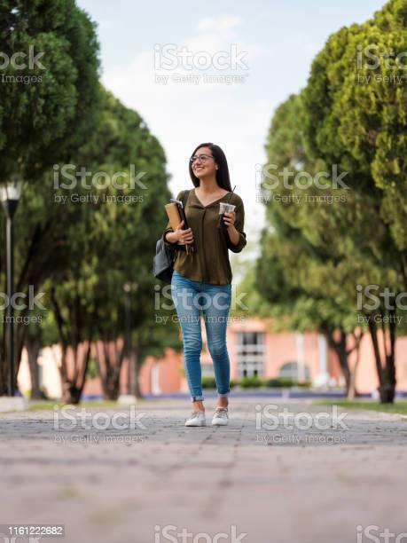 College girl walking with a soda cup picture id1161222682?b=1&k=6&m=1161222682&s=612x612&h=vxw77nyvhnjsbajito3yrn6ax95knmqqiqm ukuzjac=