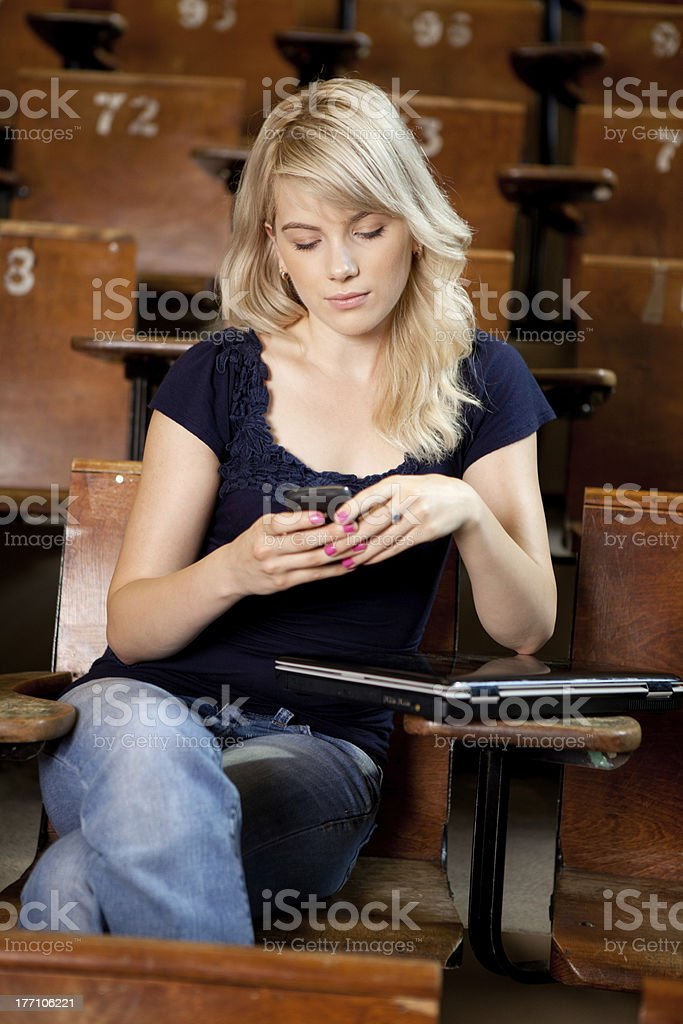 College Girl Writing SMS royalty-free stock photo