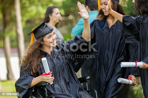 istock College girls high five after graduating from college 613884600