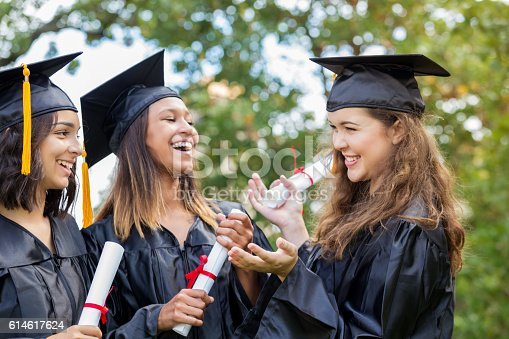 istock College girls laugh with one another after graduation 614617624