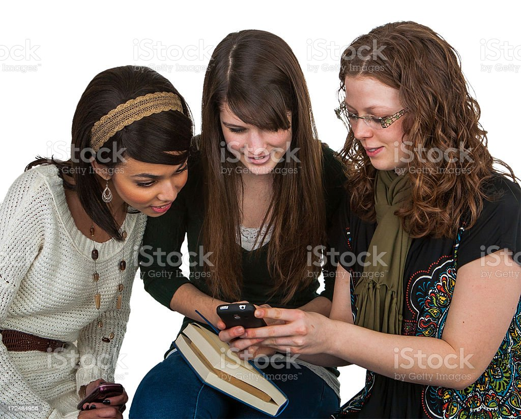 3 college girls looking at cellphone pictures royalty-free stock photo