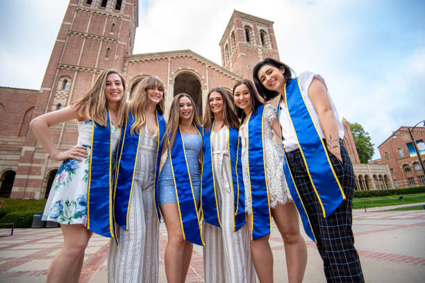 College Girls Pose Wearing Sashes for Graduation Photo Six close girlfriends pose with their sashes on for a graduation photo royce hall stock pictures, royalty-free photos & images
