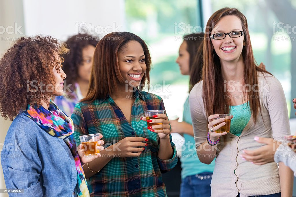 College girls talking during party or mixer at sorority event stock photo