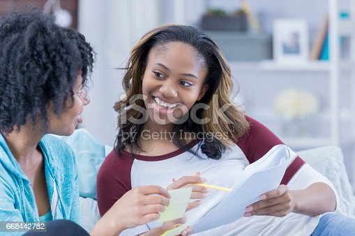 istock College girls work on homework together 668442782