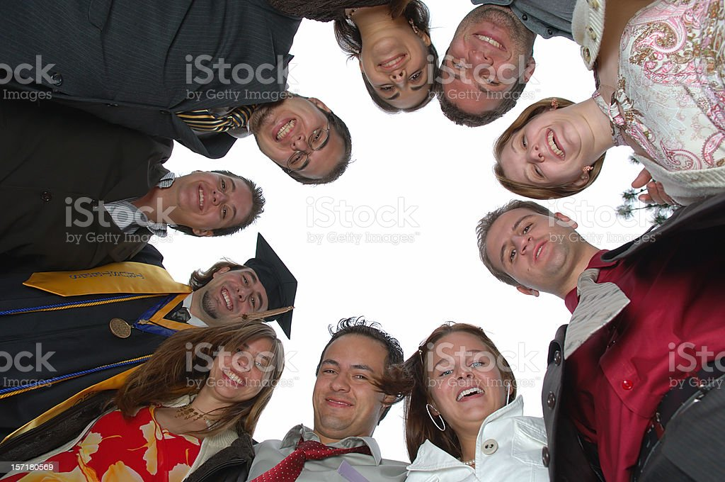 college graduate and friends celebrating royalty-free stock photo
