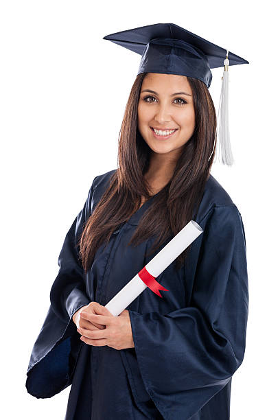 College Graduate in Cap and Gown stock photo