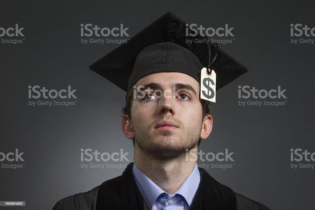 College graduate with tuition price tag on mortarboard, horizontal royalty-free stock photo