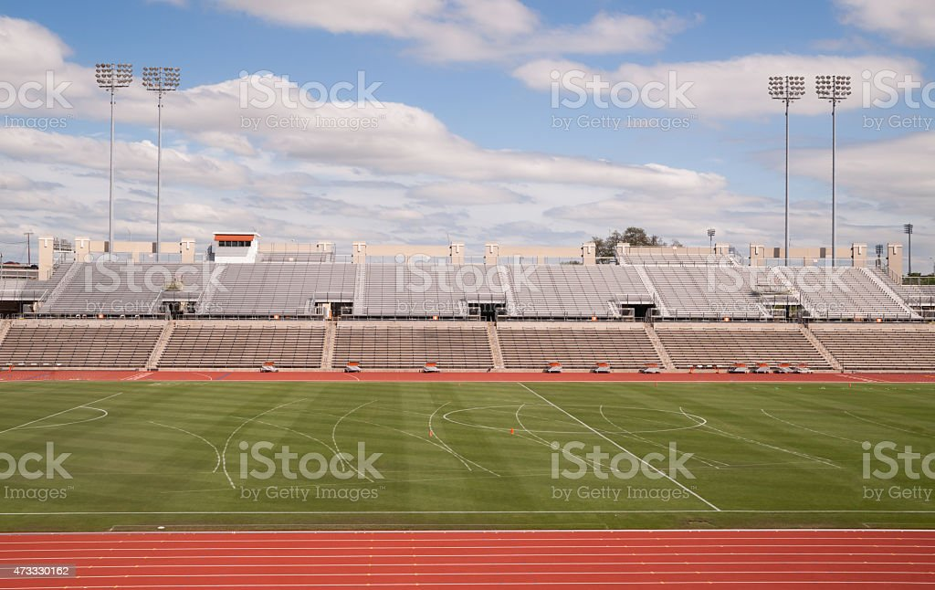 College Level Track Stadium Puffy Clouds Blue Sky stock photo